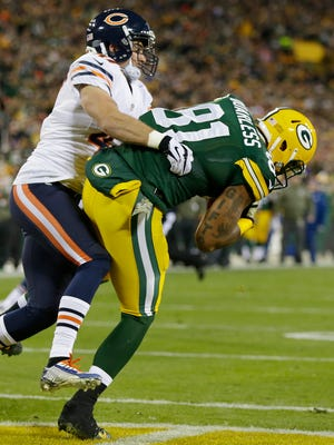 Green Bay Packers tight end Andrew Quarless (81) catches a touchdown pass against the Chicago Bears.