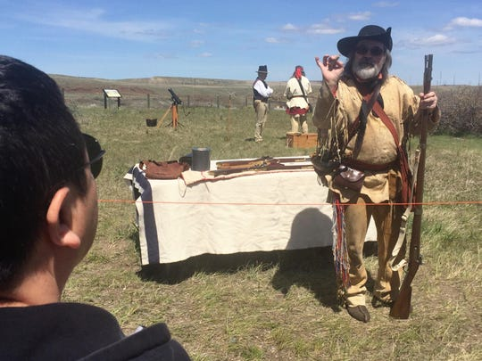 Ron Ukrainetz explains how Lewis and Clark used paper – or antelope hide in a pinch – for cartridges, at the Lewis & Clark Interpretive Center on Sunday afternoon.