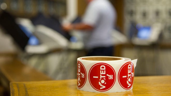 "A roll of ""I Voted"" stickers sits next to voting booths at the Cedar City Council Chambers, Tuesday, June 28, 2016."