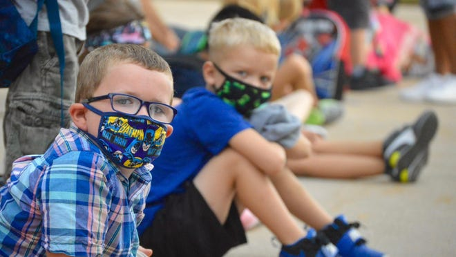 Kindergarten students line up outside Holland West Elementary, waiting for their teacher's instructions, Wednesday, Aug. 26, Holland Public Schools' first day of class. The district is asking families to prepare for a possible shift to remote learning.