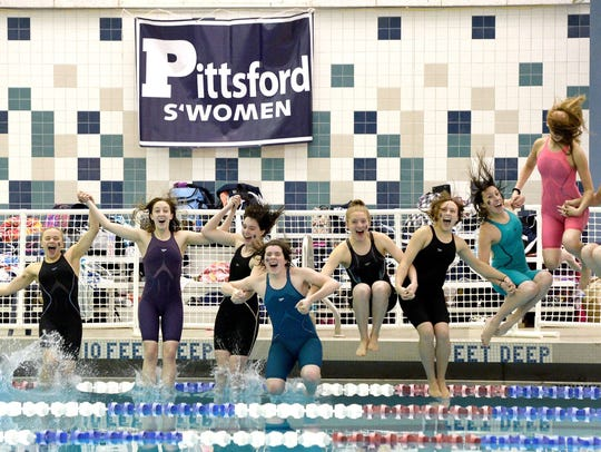 Pittsford swimmers have the celebratory dip in the