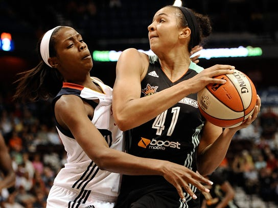 In this Aug. 14, 2015, photo, Connecticut Sun's Camille Little, left, guards New York Liberty's Kiah Stokes during a WNBA basketball game in Uncasville, Conn. Stokes has transitioned from defensive role player for the three-time defending champion Connecticut Huskies to multifaceted spark plug off the bench for the resurgent Liberty, who face the Washington Mystics on Friday in Game 1 of the Eastern Conference series. (AP Photo/Jessica Hill)