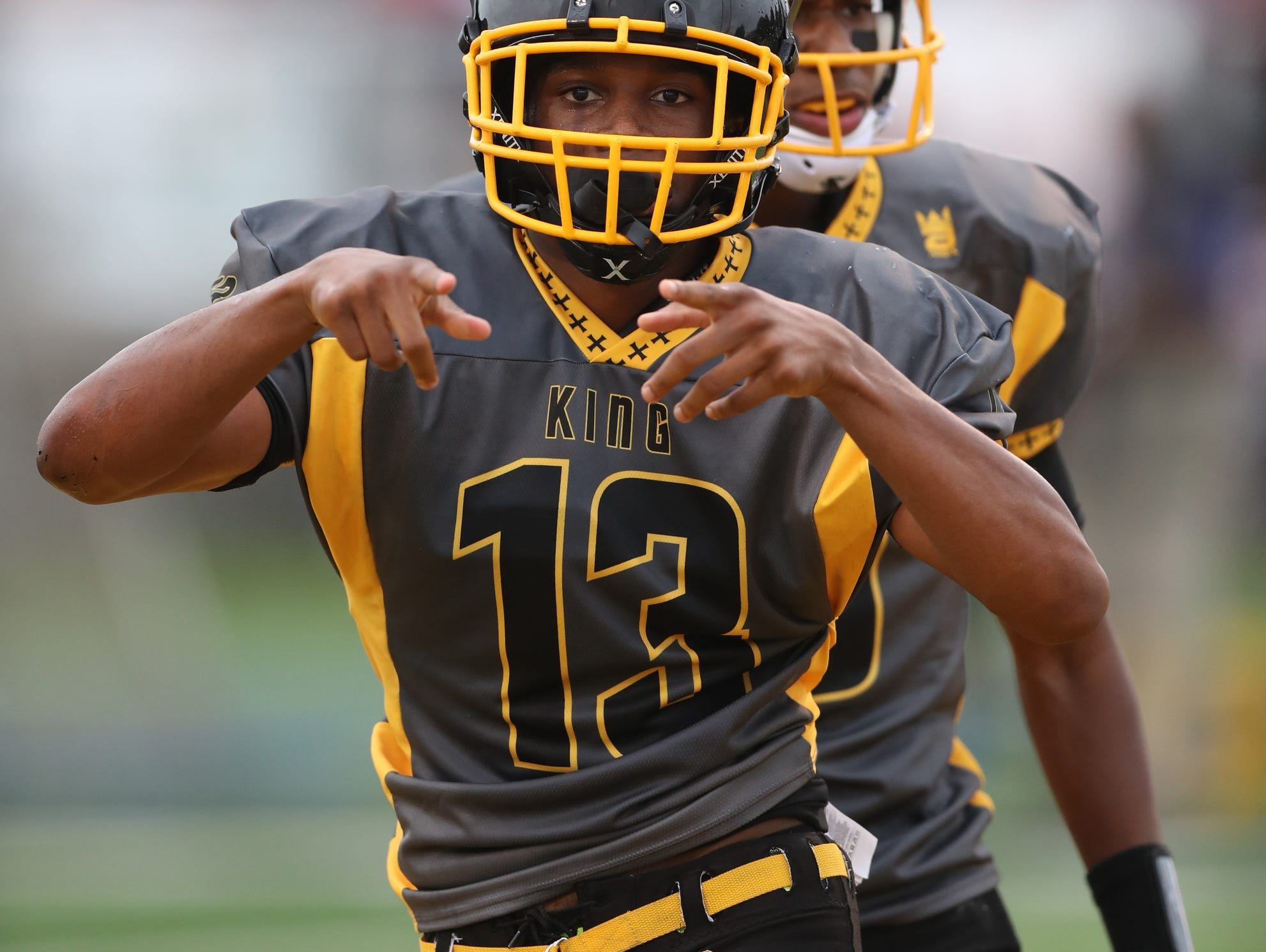 Detroit King's Ambry Thomas celebrates his touchdown against Southfield A&T during King's 39-0 win Saturday at Wayne State.