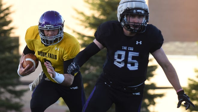 Mitchell Martin runs behind Jack Hinton (85) during the University of Sioux Falls (USF) spring football game on Friday, April 27, 2018 at the Bob Young Field in Sioux Falls, S.D.