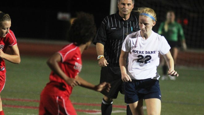 Notre Dame sophomore Ellie Vandergriff controls the ball in the first half. She scored the game's first goal seven minutes into the second half. Notre Dame and Paul Laurence Dunbar played in the girls soccer state round-of-16 Oct. 27, 2014 at Dixie Heights High School.
