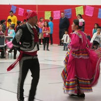Members of Grupo San Jose perform a traditional dance from the state of Jalisco in Mexico.