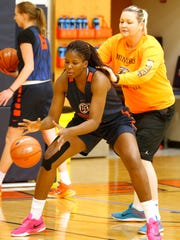UTEP forward Tamara Seda goes thorugh drills during the second day of practice in preparations for the Miners Thursday night WNIT game against Abilene Christian Thursday night in the Don Haskins Center. Helping Seda with her shooting drills is former player and graduate assistant Izabela Piekarska.
