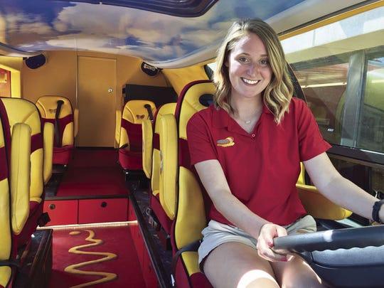 Hotdogger Lizzie Duff steers a Wienermobile.