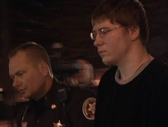 Brendan Dassey is led into court moments before a jury