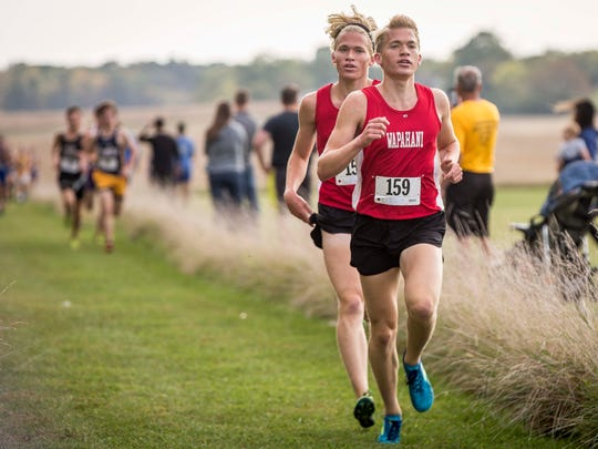 Wapahani brothers Nathan and Alex Herbst take the lead during the IHSAA Sectional Oct.7 at the Muncie Sportsplex. Muncie Central won the sectional for the boys and Delta won the sectional for the girls.