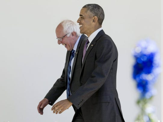 President Obama walks with Bernie Sanders down the