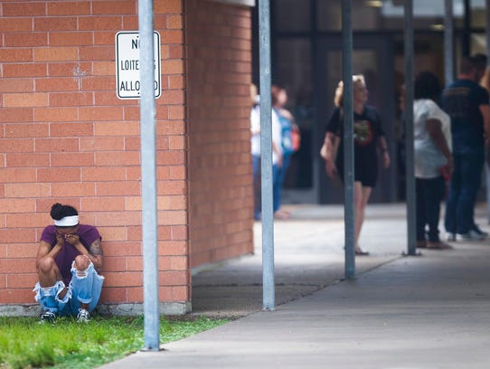People gather by the Barnett Intermediate School where