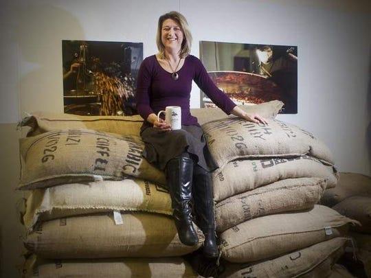 Kathy Turiano, Joe Bean Coffee Roasters co-owner, sits