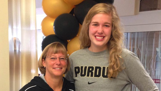 Assumption's Nora Kiesler, right, and Purdue coach Sharon Versyp
