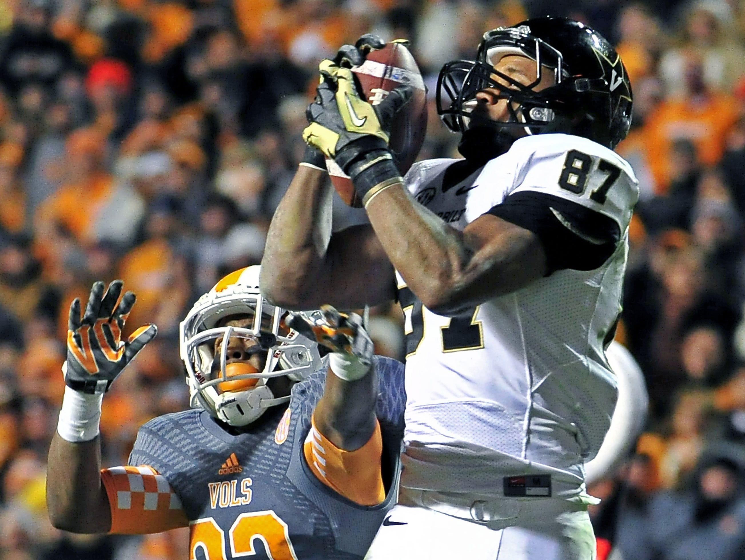 Vanderbilt wide receiver Jordan Matthews (87) catches a 25-yard pass over Tennessee defensive back Cameron Sutton in the fourth quarter to set up the winning touchdown. Vanderbilt won 14-10 at Neyland Stadium Nov. 23, 2013.