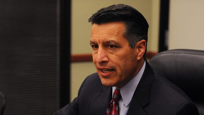 Governor Brian Sandoval speaks to the Reno Gazette-Journal editorial board in Reno on Jan. 21, 2015.