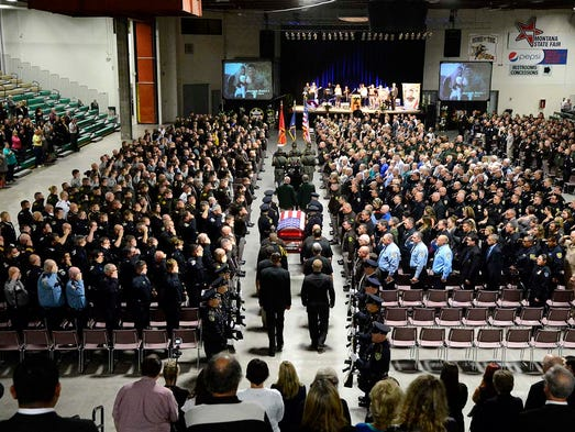The funeral procession enters Four Seasons Arena for the memorial service of Sheriff's Deputy Joe Dunn on Thursday afternoon.  The service was attended by law enforcement agencies from around the state.