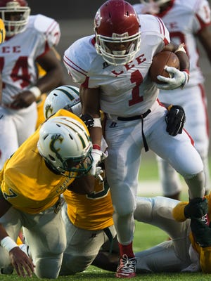 Lee running back Damion Wright (1) is tackled by Carver linebacker Eric Brow (7) and Carver defensive lineman Demonte Haigler (35) during the game between Lee High School and Carver High School on Thursday, Aug. 27, 2015, at the Cramton Bowl in Montgomery, Ala.