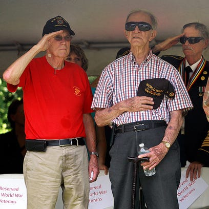 L-R U.S. Veterans Pierce Harover, Edward Bruchas, Charlie Bohn, Jack Smith, and Van Conder salute at the Memorial Day Program in Gallatin, TN on Monday May 30, 2016.