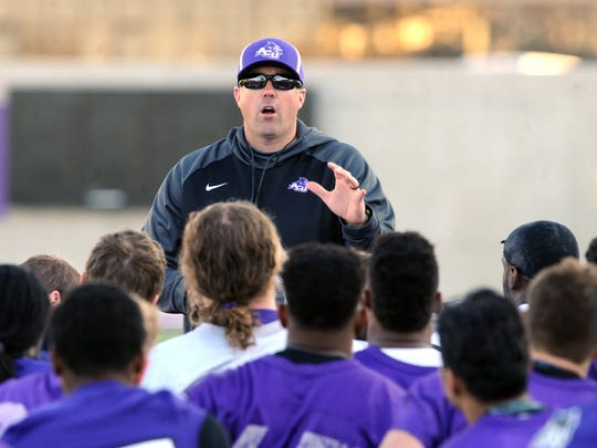 ACU coach Adam Dorrel talks to his team after Day 1 of spring practice Thursday, March 1, 2018 at Wildcat Stadium.