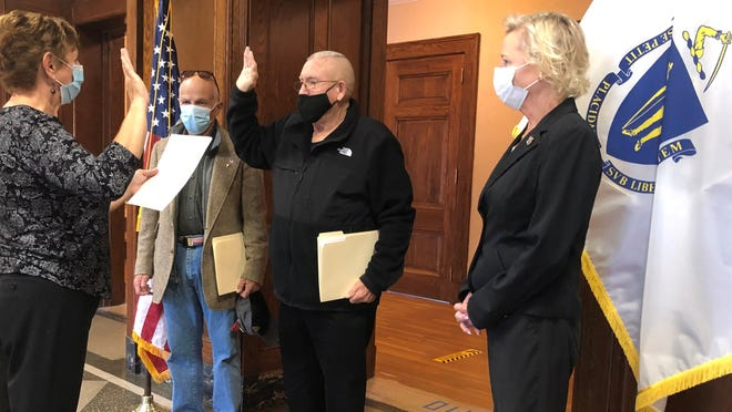 Ted Hatch is sworn in by Town Clerk Michele Bissonnette. To his left is Wareham Housing Authority Chairman Bob Powilatis. To his right is state Rep. Susan Williams Gifford, R-Wareham.