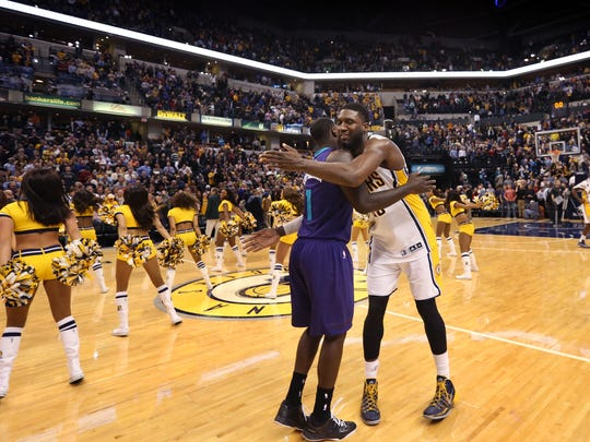Hornets guard Lance Stephenson, left, and Pacers center Roy Hibbert embrace at center court following the Pacers' win at Bankers Life Fieldhouse on Nov. 19, 2014.
