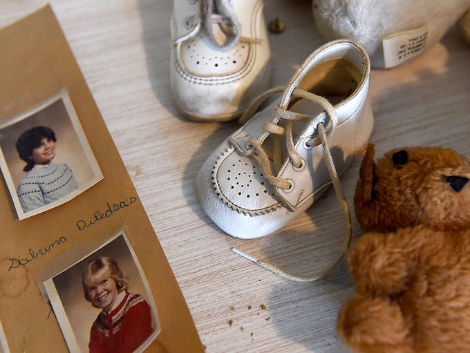 Cheri Lindsey's baby shoes and photos of school friends.