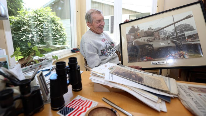 Two Rivers native Jerry Nelson, 91, has a photo of a memorial Sherman tank framed in his house on Thursday, June 30 in Two Rivers. The World War II army veteran fought in the Battle of the Bulge in a Sherman tank with the Seventh armored Division in 1944.