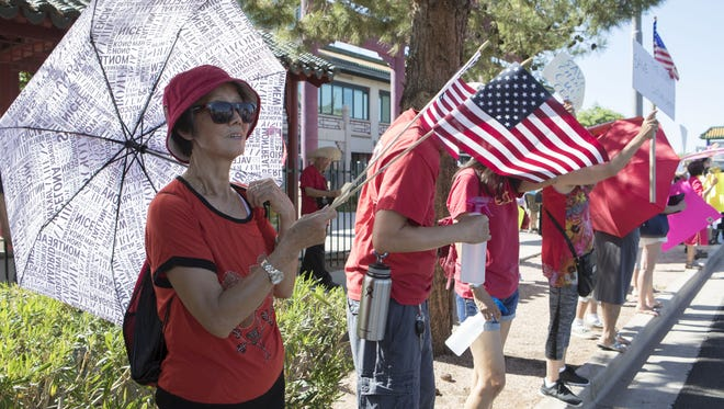 Protesters rally at the Chinese Cultural Center in Phoenix on Sunday, Aug. 13, 2017.