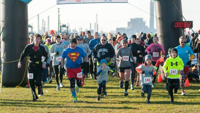 Runners take off Sunday, Nov. 13, during the P.S. You're My Hero run/walk along the Blue Water River Walk.