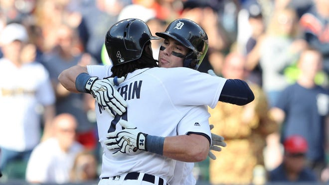 James McCann celebrates his first homer of the year with Cameron Maybin, who scored from first base on the blast, on Saturday, May 21, 2016 at Comerica Park.