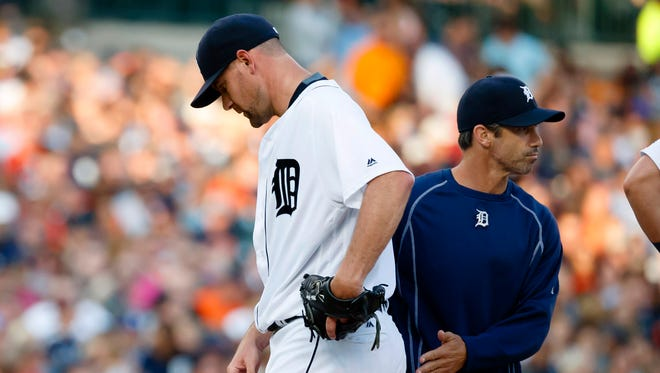 Jul 16, 2016; Detroit, MI, USA; Detroit Tigers manager Brad Ausmus takes the ball to relieve starting pitcher Mike Pelfrey in the second inning against the Kansas City Royals at Comerica Park.