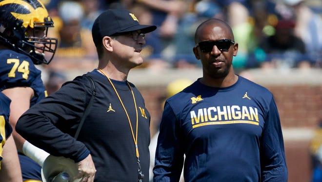 Apr 15, 2017; Ann Arbor, MI, USA; Michigan Wolverines head coach Jim Jim Harbaugh and assistant Pep Hamilton during the spring game at Michigan Stadium.