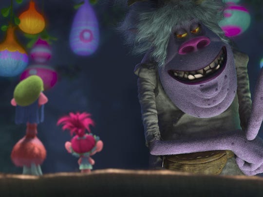 From left: Trolls King Peppy (voiced by Jeffrey Tambor), Cooper (voiced by Ron Funches) and Poppy (voiced by Anna Kendrick) are confronted by the fearsome Bergen Chef (voiced by Christine Baranski).