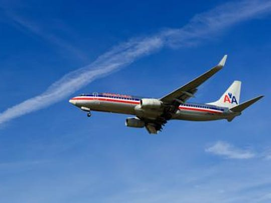An American Airlines jet prepares to land at Ronald Reagan National Airport in February 2014