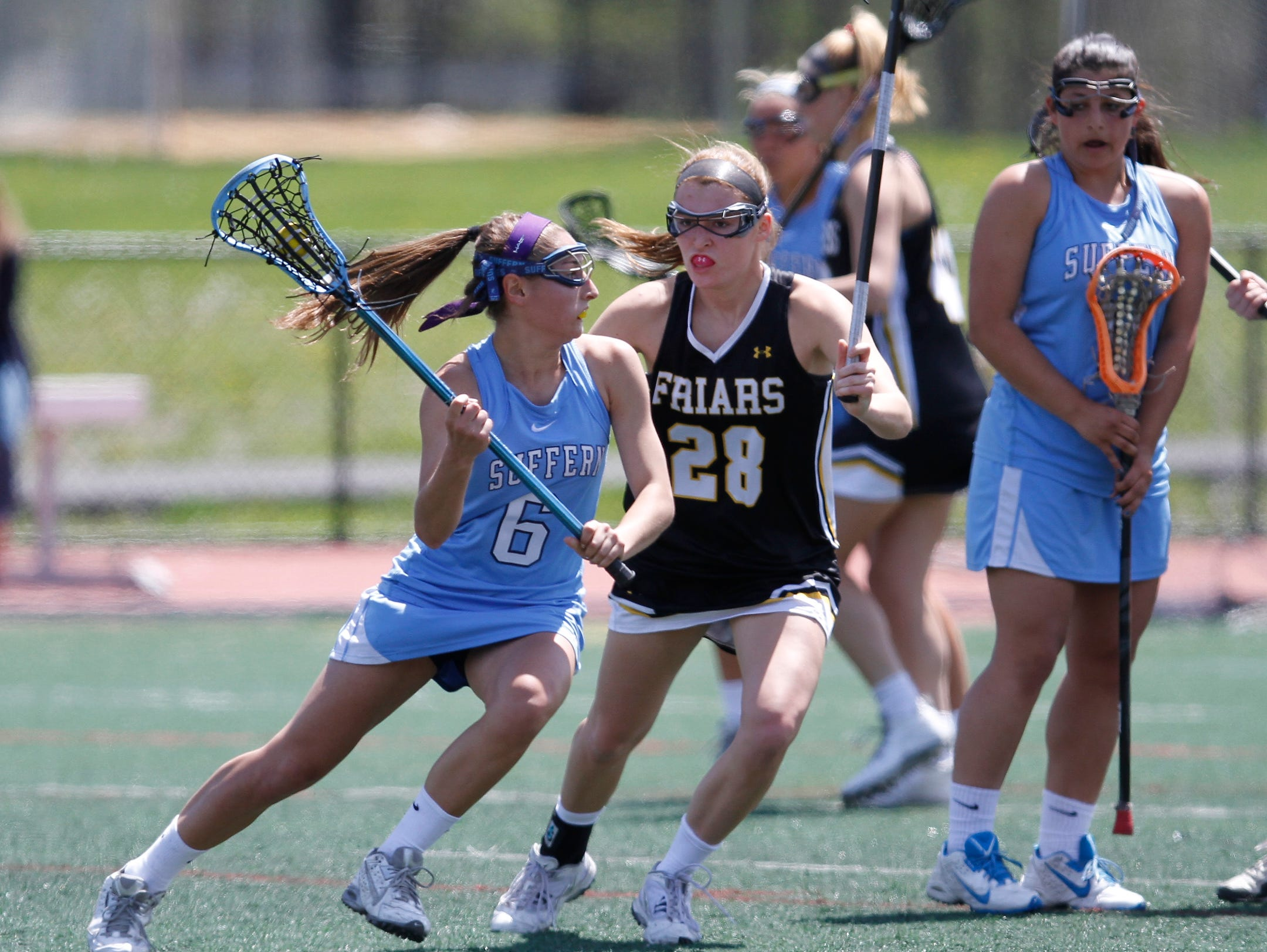 Suffern's Hannah Newman (6) works the ball against a St. Anthony defender during a girls lacrosse game at Suffern Middle School in Suffern on Saturday, April 30, 2016. Suffern won 8-7.