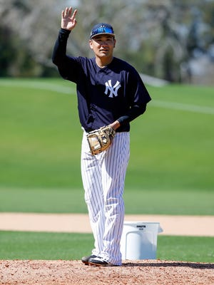 New York Yankees starting pitcher Masahiro Tanaka asks for another turn at fielding a hot shot back at the mound during spring training workouts at George M. Steinbrenner Field.
