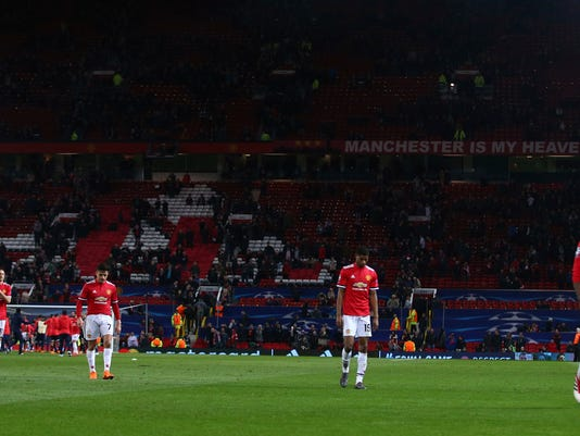 Manchester United's Alexis Sanchez head down, third left walks with is teammates off the pitch after the end of the Champions League round of 16 second leg soccer match between Manchester United and Sevilla, at Old Trafford in Manchester, England, Tuesday, March 13, 2018. Sevilla won the game 2-1 and go through to the quarterfinals .(AP Photo/Dave Thompson)