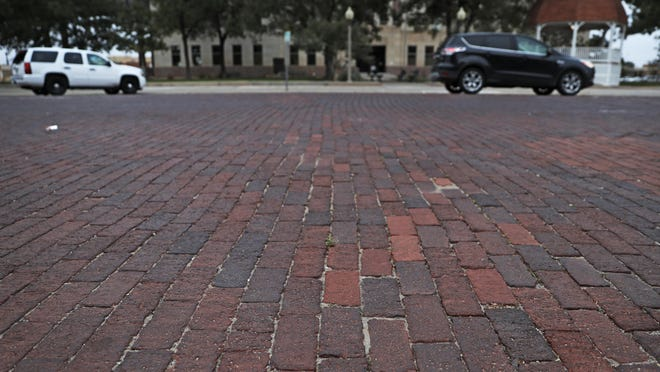 The red bricks paving the streets around downtown were designated a historical landmark, Tuesday, Oct. 29, 2019, in Lubbock, Texas.