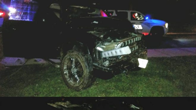 Police say the teen driver of this SUV was drunk when the car crashed into a stone wall, a tree and a fence before stopping in front of the Ocean Aire apartments.