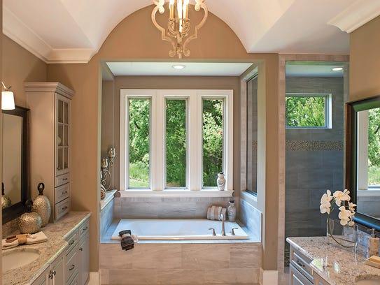 The Camden owner's bath creates an oasis where you