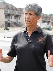 Hilda Kogut from Chestnut Ridge talks about over building in the unincorporated sections of Ramapo and Chestnut Ridge near a construction site in Spring Valley last week.