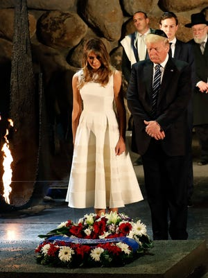 President Trump and his wife Melania attend a wreath laying ceremony during a visit to the Yad Vashem Holocaust Memorial museum in Jerusalem on May 23, 2017.