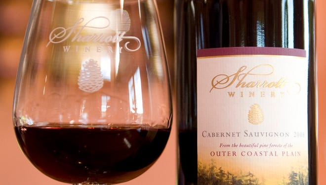 A bottle and glass of Cabernet Sauvignon sit in the tasting room of Sharrott Winery in Winslow Township. Sharrott Winery in Blue Anchor will host a special tasting experience on Nov. 19 and 20