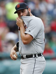 Tigers pitcher Michael Fulmer reacts after giving up
