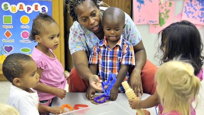 Students work with Jacquie Greene, the lead teacher for 2-year-olds at the Sussex Tech High School daycare.