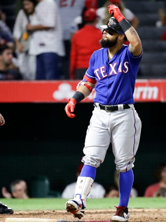 Texas Rangers' Rougned Odor tosses his bat after striking out against the Los Angeles Angels during the seventh inning of a baseball game in Anaheim, Calif., Saturday, Sept. 16, 2017. (AP Photo/Chris Carlson)