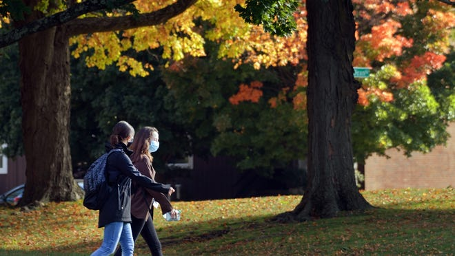 WORCESTER - Two women walk through Institute Park amid fall foliage Monday.
