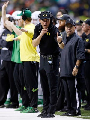 Jan 2, 2016; San Antonio, TX, USA; Oregon Ducks head coach Mark Helfrich on the sidelines during the game against the TCU Horned Frogs in the 2016 Alamo Bowl at the Alamodome. Mandatory Credit: Erich Schlegel-USA TODAY Sports