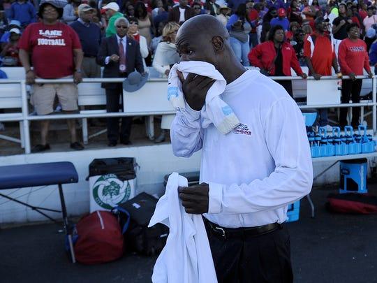 Lane College head coach Derrick Burroughs wipes his